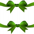 Green bow with ribbon on the gift or heart isolated — Stock Photo
