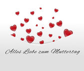 White card, pocket with red hearts tucked away in German — Stock Photo