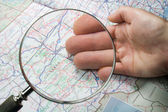 Lupa sobre o mapa — Foto Stock
