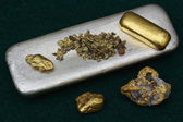 Gold Bar, Natural Gold Nuggets and Silver Ingot — Stock Photo