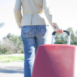 Womleaving with red suitcase. — Stock Photo #41944641