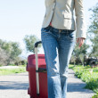 Womleaving with red suitcase. — Stock Photo #41944651