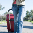 Womleaving with red suitcase. — Stock Photo #41944677