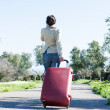 Womleaving with red suitcase. — Stock Photo #41945177