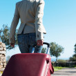 Womleaving with red suitcase. — Stock Photo #41945203