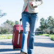 Womleaving with red suitcase. — Stock Photo #41945227