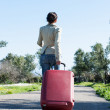Womleaving with red suitcase. — Stock Photo #41945239