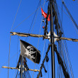 Black masts with a pirate flag  — Stock Photo