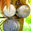 Round tin pots in a tropical restaurant — Stock Photo