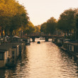 Amsterdam channel with boat houses — Stock Photo