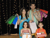 Family carrying gifts for Diwali — Stock Photo
