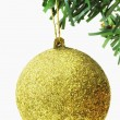 Stock Photo: Golden bauble hanging on a Christmas tree