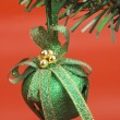 Green Christmas bell hanging on a Christmas tree — Stock Photo