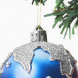 Blue bauble hanging on a Christmas tree — Stock Photo
