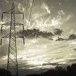 Clouds over an electricity pylon — Stock Photo