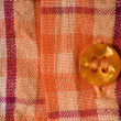 Close-up of a orange plaid shirt — Stock Photo