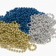 Strings of blue gold and silver beads — Stock Photo