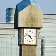 Clock tower in front of office buildings — Foto Stock