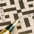 Crossword puzzle with a pen — Stok fotoğraf