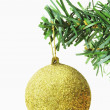 Golden bauble hanging on a Christmas tree — Stock Photo