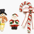 Candy cane, Santa Claus and snowman — Stock Photo