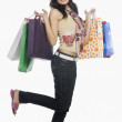 Woman carrying shopping bags and smiling — Stock Photo