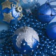 Blue Christmas balls with a string of blue beads — Stock Photo