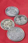 Silver coins on red background — Stock Photo