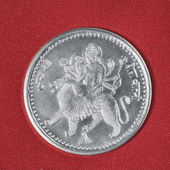 Silver coin on red background — Stock Photo