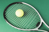 Tennis racket with a tennis ball — Stock Photo
