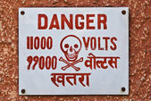 High Voltage warning signboard on a wall — Stock Photo