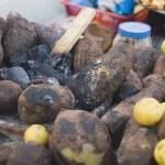 Sweet potatoes with lemons — Stock Photo