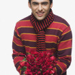 Man holding a bouquet of flowers — Stock Photo #32947655