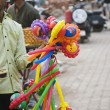 Vendor selling toys in street market — Stock Photo #32947663