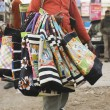 Vendor selling bags in a street market — Stock Photo