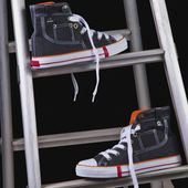 Shoes on a step ladder — Stock Photo