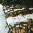 Tables and chairs at a sidewalk cafe, Athens — Stock Photo #32950085