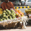 Vendor selling fruits at market stall — Stock Photo #32950873