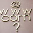 Question mark with internet symbols — Stock Photo #32954049