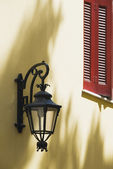 Lantern mounted a wall — Stock Photo