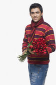 Man holding a bouquet of flowers — Stock Photo