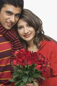 Par med blommor — Stockfoto