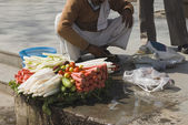 Vendor selling vegetable in a street — Stock Photo