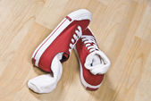 Pair of canvas shoes with socks — Stock Photo