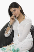 Woman talking on a mobile phone — Stock Photo