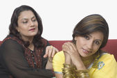 Woman consoling her daughter — Stock Photo