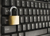Padlock on a computer keyboard — Stock Photo