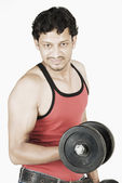 Man exercising with dumbbells — Foto Stock