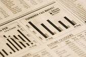 Bar graph on a financial newspaper — Stock Photo