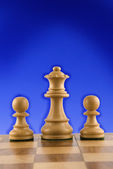 Chess queen and pawns — Stock Photo